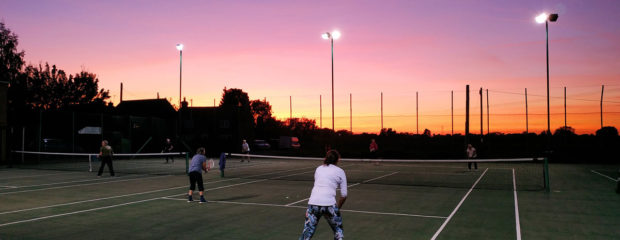 Wistow Tennis Club members enjoying the sunset on a September evening